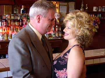 Sergeant Frank Monday (Kevin Croak) and Ginger (Laura Parish)